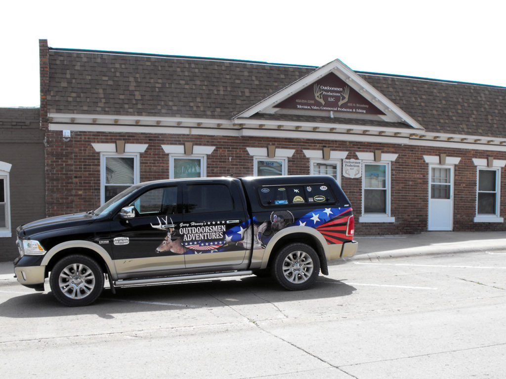 Office front of the building with Dodge truck